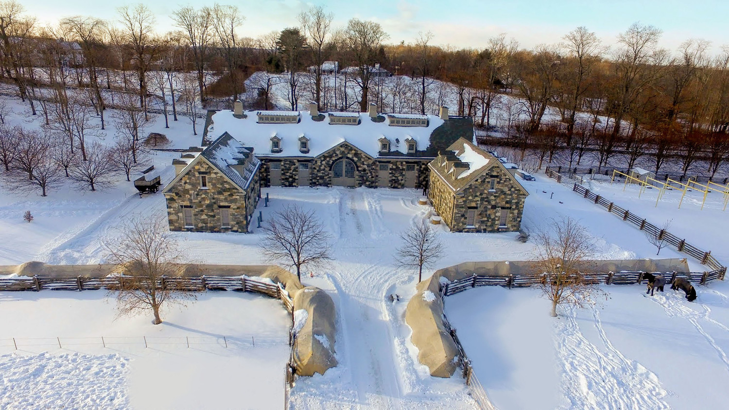 overhead drone shot of marthas home in winter