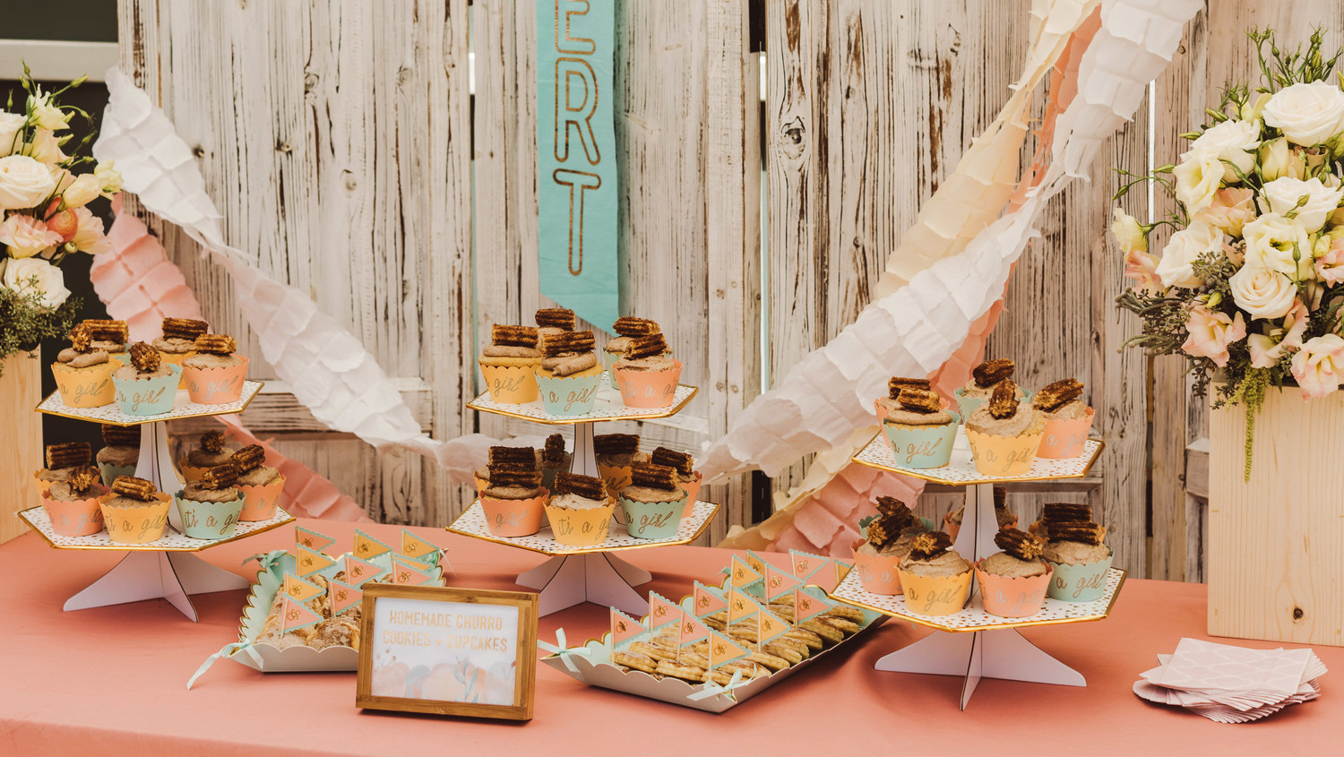 mint blush baby shower cupcakes dessert table with flowers