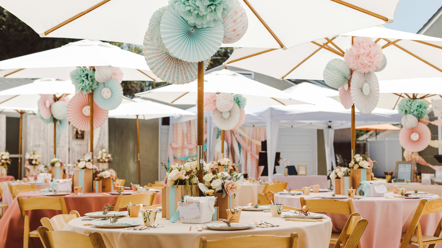 mint blush baby shower decorated space with chairs tables umbrellas
