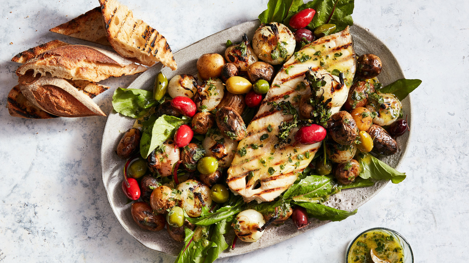Grilled Halibut Steaks with Potatoes, Olives, and Onions