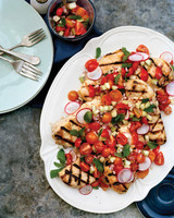 Grilled Chicken with Cucumber, Radish, and Cherry Tomato Relish on white plate