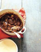 coq au vin with serving spoon