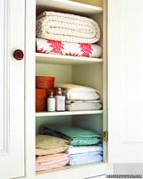 organized closet sheets blankets