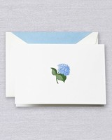crane stationary with blue accent flower