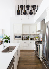 white kitchen with guitars kelsea ballerini