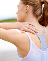 woman sore muscles
