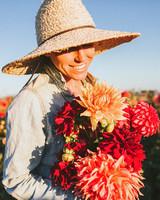 farmer holding dahlia flowers