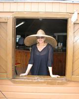 m_wearing_kevins_hat_for_al.jpg