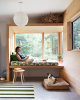woman sitting in window seat in mudroom