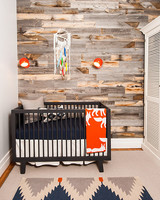 rustic nursery with plank wall
