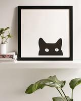 framed black cat peeking print