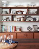 open walnut shelving in kitchen