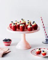 filled strawberries on cake platter