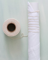 roll of twine with twine wrapped fabric pole