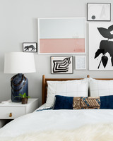 neutral bedroom with blue lamps and decorative pillow