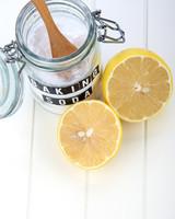 jar of baking soda and a sliced lemon
