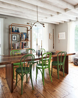 dining area with vintage green chairs