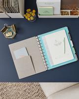 linen notebooks on navy desk