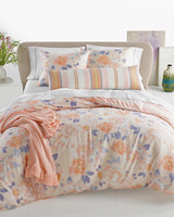whim pink floral comforter on bed