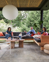 back porch with sectional couch globe light