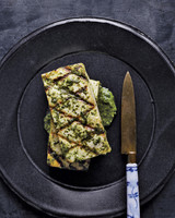 tofu with ginger cilantro sauce served on a black plate