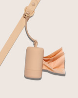 tan poop bag and leash