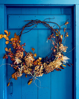 wreath hanging on blue door