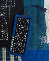 blue fabric bookmark with ribbon