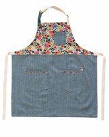 A floral and denim apron by Hedley and Bennett, with design by Rifle Paper Company.
