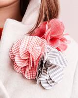 flower pin on little girl's coat close up