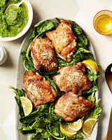 chicken with herbed pea puree and spinach on plate