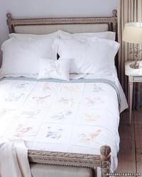 Bird-Embroidered Quilt
