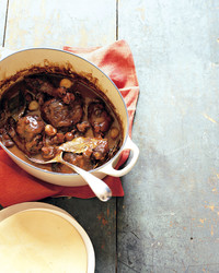 coq au vin with serving spoon