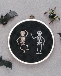Ready to Get Spooky? These Cross-Stitched Skeletons Glow in the Dark