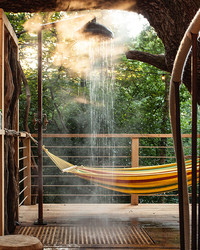 The Treehouse Spa You Wish You Had in Your Backyard