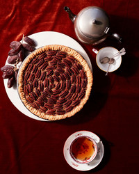 date-nut pie on red table cloth with tea