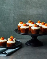 pumpkin cupcakes on cakestand and plate