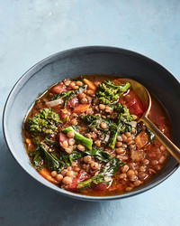 vegan lentil soup in bowl on blue table