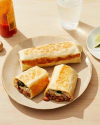 freezer burritos on tan plate