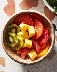 tropical fruit juice salad with pineapple and kiwi