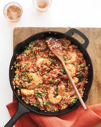 skillet rice chorizo shrimp with wooden spoon