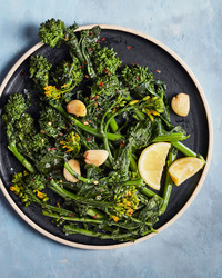 simply sauteed broccoli rabe healthy sidedish on blue table