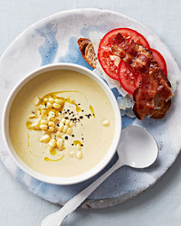 Corn soup with tomato-bacon toasts