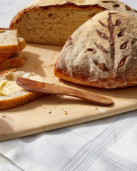 artisan boule bread martha bakes cutting board slice butter