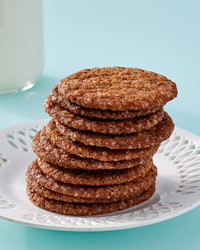 stack of molasses ginger crisps on white plate