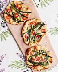 grilled-asparagus, tomato, and fontina pizzette
