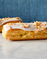 coconut eclairs pate a choux martha bakes blue background