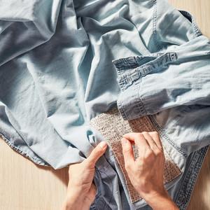 woman mending jeans