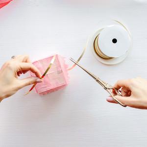 diy pinata box step 4 clipping gold ribbon