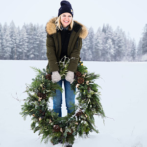 woman carrying wreath